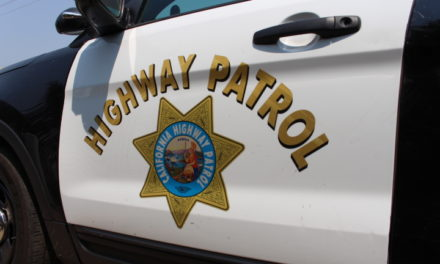 Vehicle on its side reported in Merced