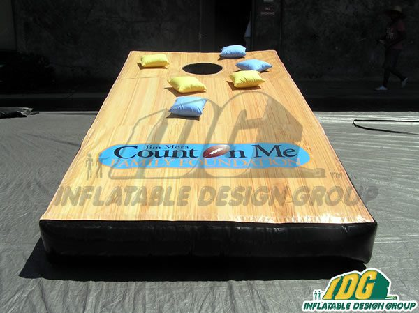 INFLATABLE CORN HOLE GAME IS A BLAST FROM THE PAST! 7