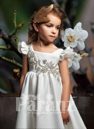 A-line long dobby dress with ruffle ending and rhinestone work bodice close view
