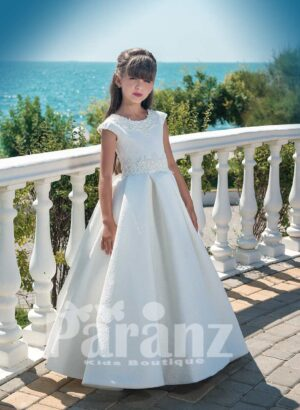 Beautiful all white dobby gown with tulle underneath skirt and pearl appliquéd bodice