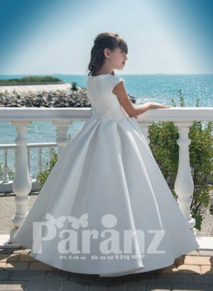 Beautiful all white dobby gown with tulle underneath skirt and pearl appliquéd bodice side view