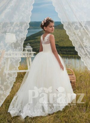 Beautiful appliqué bodice and organza tulle skirt dress in white side view