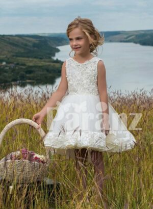 Beautiful rosettes bodice dress with tulle skirt in white hue