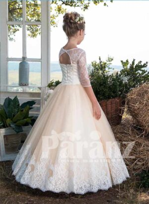 Beautiful soft lace, satin, and sheer dress with long tulle skirt back side view
