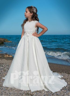 Elegant dobby long gown with flower appliquéd mid belt and tulle underneath skirt