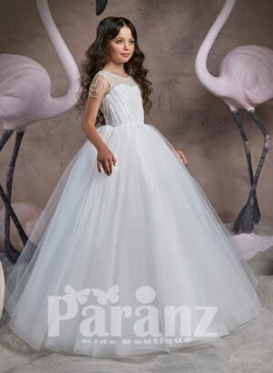 Elegant floor length sheer-satin gown with tulle underneath skirt and stylish pearl studded bodice