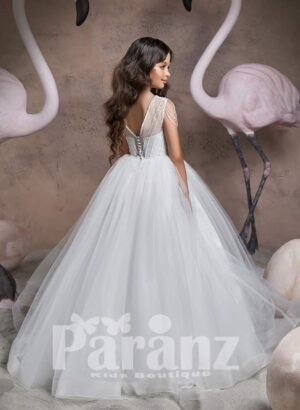Elegant floor length sheer-satin gown with tulle underneath skirt and stylish pearl studded bodice back side view