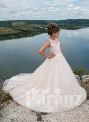 Elegant long white party gown with tulle skirt with long trail