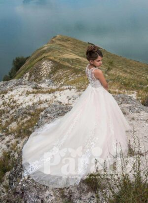 Elegant long white party gown with tulle skirt with long trail side view