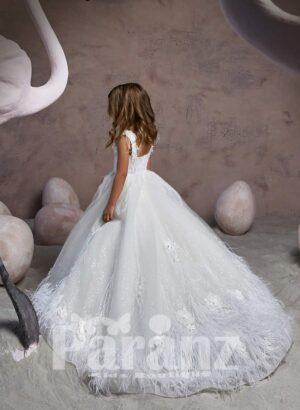 Elegant ruffle hem long tulle skirt dress with soft bodice and flower appliquéd neckline side view