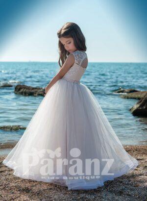 Elegant satin-sheer white flower appliquéd flower dress with long tulle skirt side view