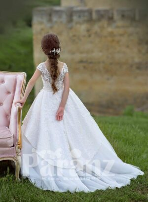 Elegant tulle skirt dress with rich satin over skirt and designer bodice back side view