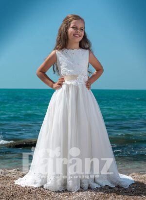 Floor length white tulle skirt dress with soft satin-sheer bodice and mid beige belt