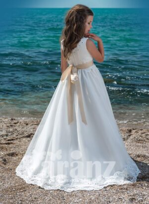 Floor length white tulle skirt dress with soft satin-sheer bodice and mid beige belt side view