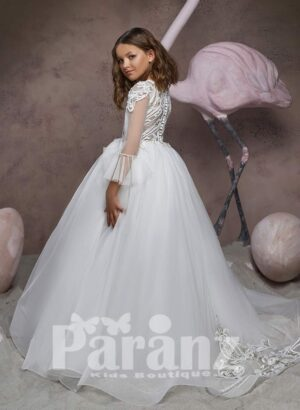High volume tulle skirt dress with major white appliqué works and wing sleeves side view