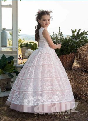Long pink hue tulle skirt dress with white lace overskirt side