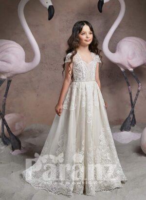 Long tulle skirt dress with white flower appliquéd hem and princess bodice