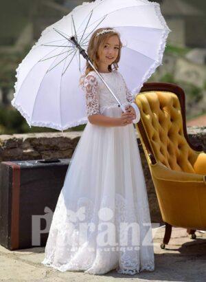 Long tulle white skirt with appliquéd hem and rich satin-sheer appliquéd bodice