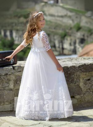 Long tulle white skirt with appliquéd hem and rich satin-sheer appliquéd bodice back side view