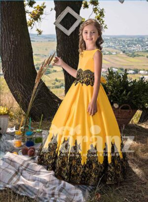 Pigmented yellow satin gown with tulle underneath skirt