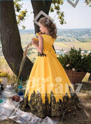 Pigmented yellow satin gown with tulle underneath skirt side view