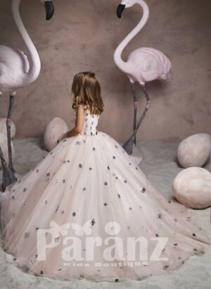 Sheer-satin long tulle skirt dress with small black flower appliqués all over back side view