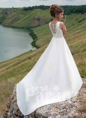 Sleeveless satin gown dress with tulle underneath skirt in white backside view