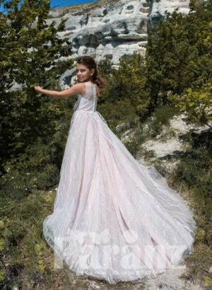 Soft summer party dress with long and back wide tulle skirt in pinkish white back side view
