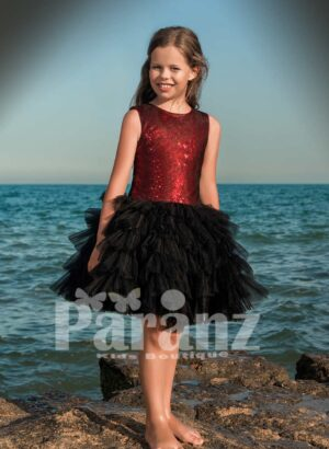 Tea length cloud tulle skirt dress with rich red sequin bodice