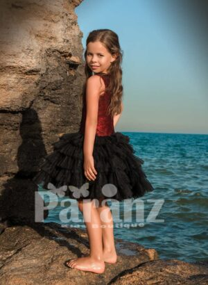 Tea length cloud tulle skirt dress with rich red sequin bodice side view