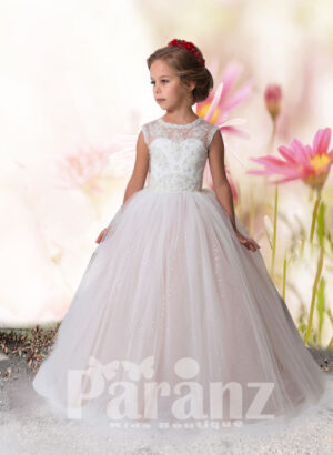 Beautiful white pearl and sequin flower bodice with long white hue tulle skirt