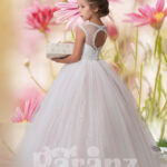 Beautiful white pearl and sequin flower bodice with long white hue tulle skirt Side view