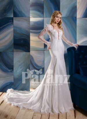 Elegant long trail white tulle wedding gown with full sleeve appliquéd bodice