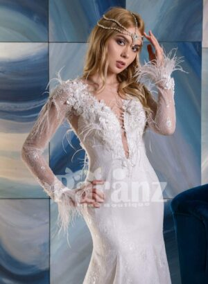 Elegant long trail white tulle wedding gown with full sleeve appliquéd bodice close view