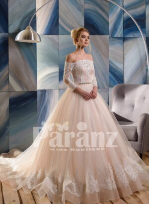 Long trail lace hem royal tulle wedding gown in ivory