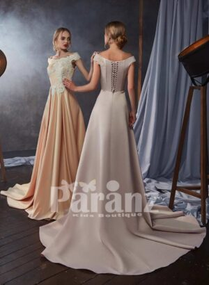 Long trail pleated rich satin gown with soft appliquéd bodice side view