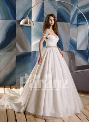 Long trail satin wedding gown with tulle underneath skirt