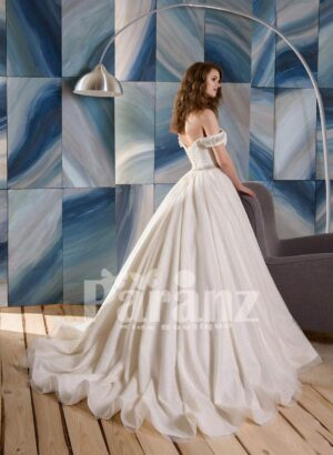 Long trail satin wedding gown with tulle underneath skirt side view