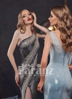 Long trail side slit glitz evening gown with stylish feather work close view