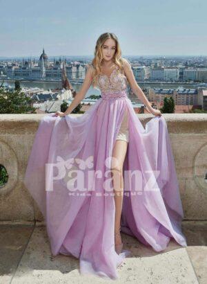 Long trail side slit soft tulle gown with elegantly appliquéd bodice
