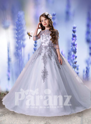 Long trail tulle skirt gown with sheer-satin bodice and major rhinestone and threaded appliqués