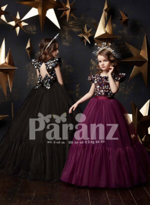 Long tulle skirt dress with colorful appliquéd bodice and cap sleeve