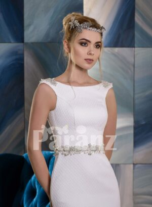 Long wedding satin gown with elegant mid-belt and appliquéd bodice close view