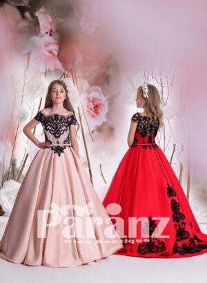 Off-shoulder rich satin gown with black major appliqué designs