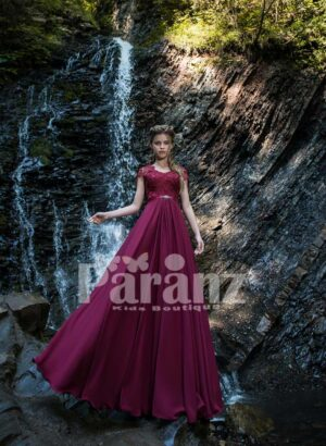 Rich and smooth pigmented long satin gown with royal appliquéd bodice