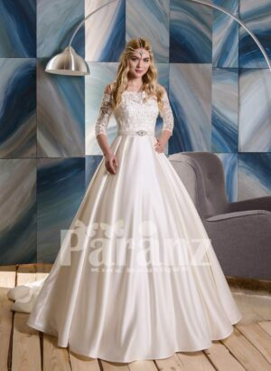 Rich satin wedding gown with tulle underneath skirt and appliquéd bodice