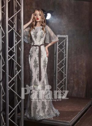 Satin-tulle evening party gown with all over appliqués and wing sleeves