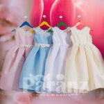 Simple tea length satin skirt dress with pearl and flower appliquéd neckline for kids