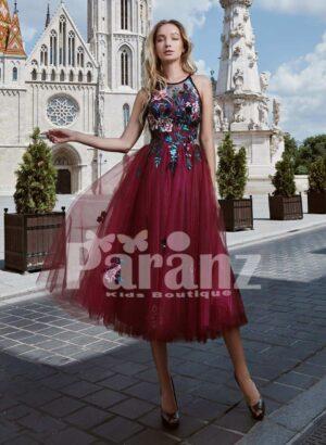 Tea length soft tulle gown with elegant rosette appliquéd bodice