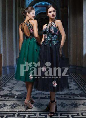 Tea length soft tulle gown with elegant rosette appliquéd bodice side view